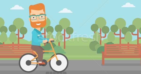 Homem equitação bicicleta barba parque Foto stock © RAStudio