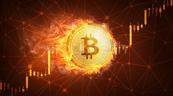 Bitcoin coin in fire with bull stock chart. Stock photo © RAStudio