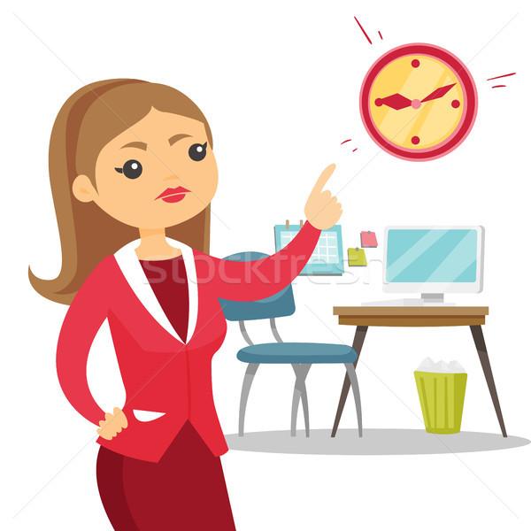 Enojado caucásico empleador senalando tiempo reloj Foto stock © RAStudio