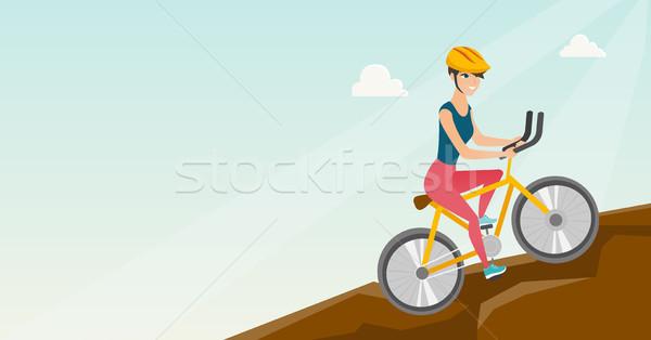 Fiatal nő bicikli utazó hegyek fiatal boldog Stock fotó © RAStudio