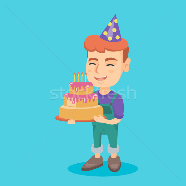 Caucasian child holding birthday cake with candles Stock photo © RAStudio