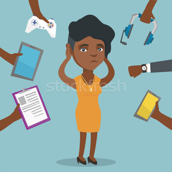 Young african-american woman surrounded by gadgets Stock photo © RAStudio