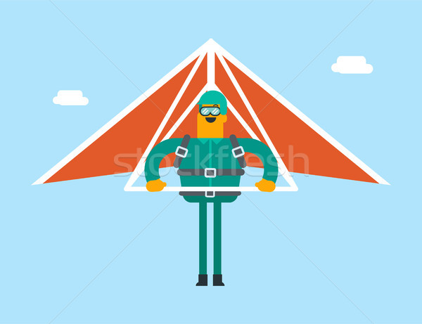 Caucasian white man flying on hang-glider. Stock photo © RAStudio