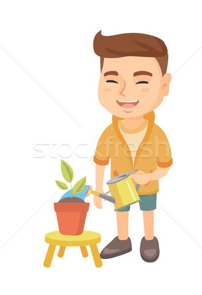 Caucasiano menino planta regador pequeno Foto stock © RAStudio