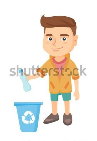 Boy throwing plastic bottle in recycle bin. Stock photo © RAStudio