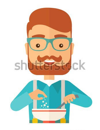 Young caucasian is eating salad for lunch in the restaurant. Stock photo © RAStudio