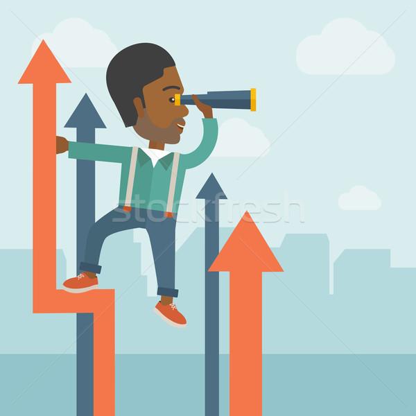 Sikeres afrikai üzletember áll felső grafikon Stock fotó © RAStudio