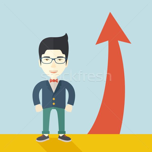 Asian Businessman standing beside the red arrrow Stock photo © RAStudio