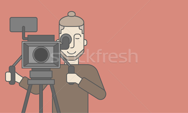 Cameraman with beard looking through movie camera Stock photo © RAStudio
