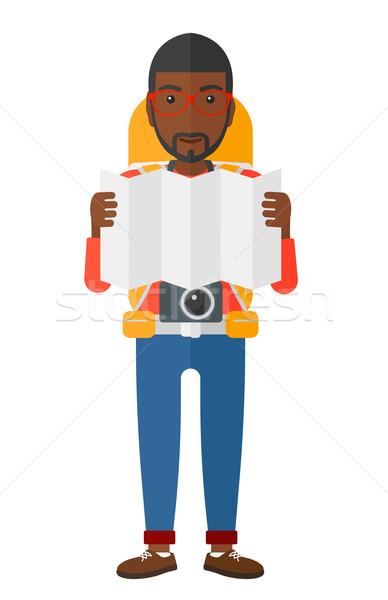Zaino in spalla guardando mappa fotocamera vettore design Foto d'archivio © RAStudio
