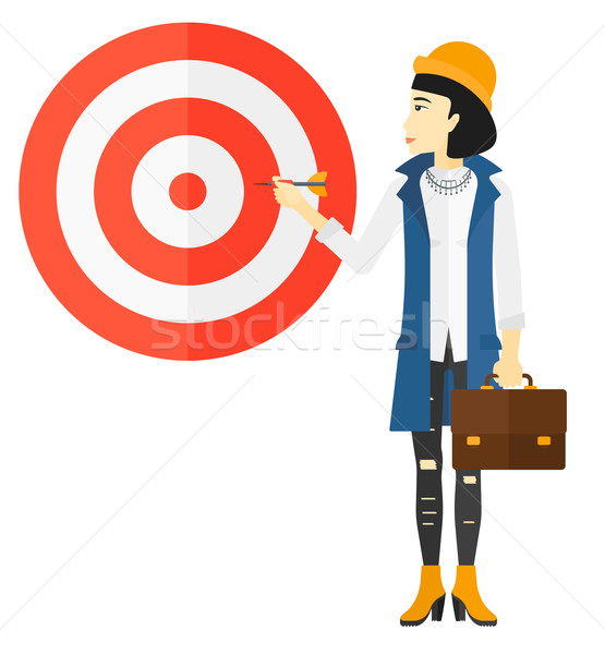 Business woman with target board. Stock photo © RAStudio