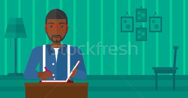 Reporter with writing-pad. Stock photo © RAStudio