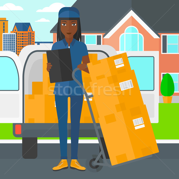 Woman delivering boxes. Stock photo © RAStudio