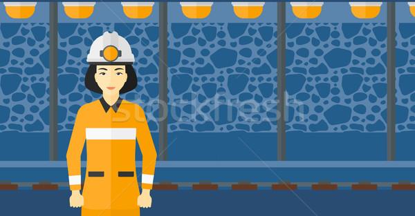 Casco de seguridad Asia mujer antorcha minería túnel Foto stock © RAStudio