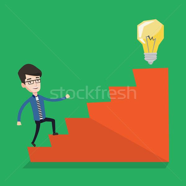 бизнесмен ходьбе наверх Идея лампа молодые Сток-фото © RAStudio