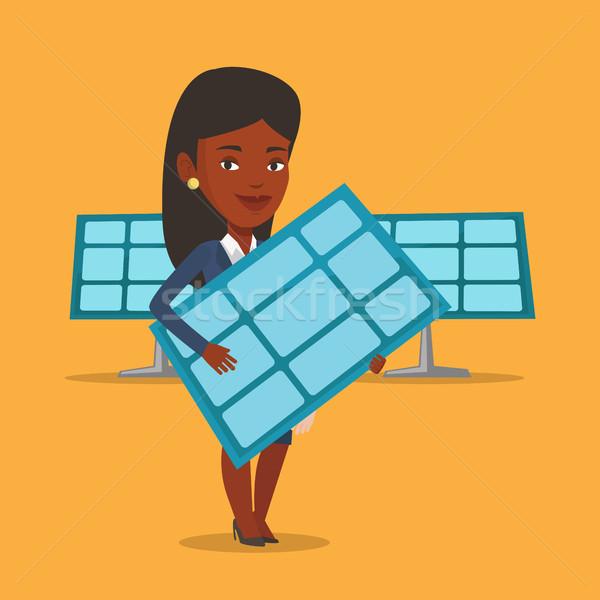 Vrouw zonnepaneel afrikaanse werknemer Stockfoto © RAStudio