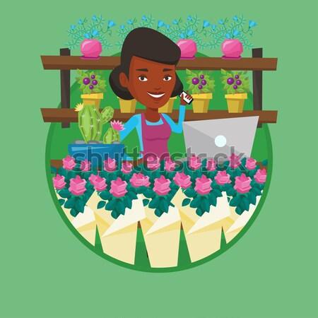 花屋 花屋 アフリカ 所有者 電話 ノートパソコン ストックフォト © RAStudio