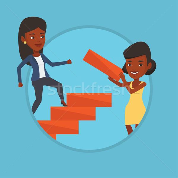 Business woman runs up the career ladder. Stock photo © RAStudio