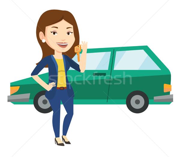 Woman holding keys to her new car. Stock photo © RAStudio