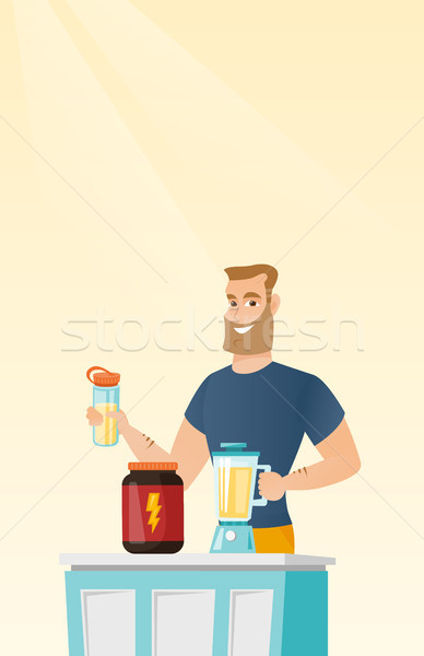 Young man making protein cocktail. Stock photo © RAStudio