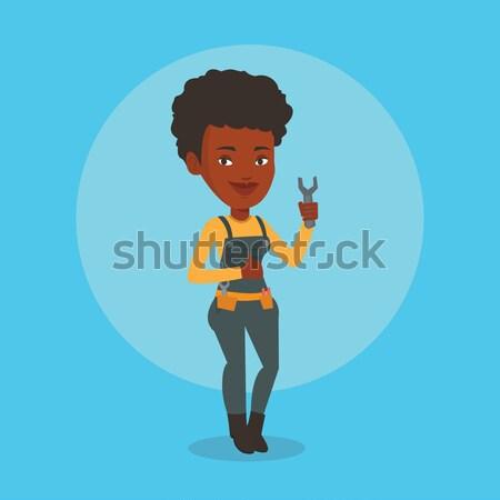小さな スパナ 笑みを浮かべて 女性 ストックフォト © RAStudio