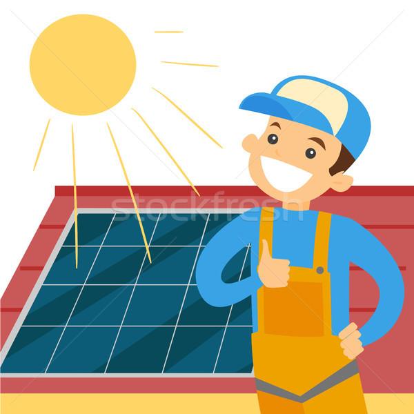 Caucasian white constructor installing solar panel Stock photo © RAStudio