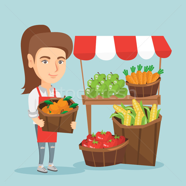 Caucasian street seller with fruits and vegetables Stock photo © RAStudio