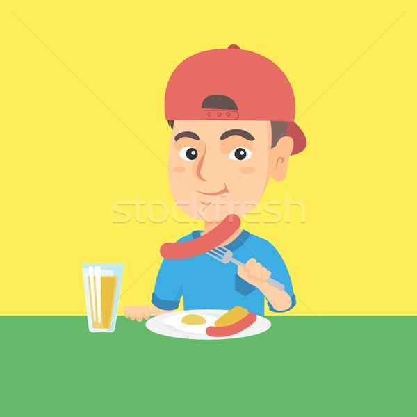 Boy eating sausage and fried egg for breakfast. Stock photo © RAStudio