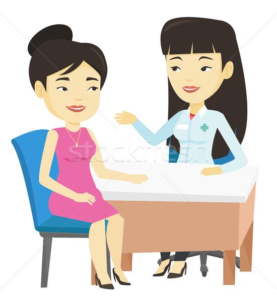 Lekarza konsultacji kobiet pacjenta biuro asian Zdjęcia stock © RAStudio