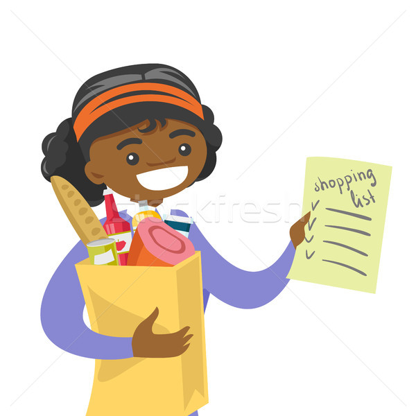 Woman checking shopping list in the grocery store. Stock photo © RAStudio