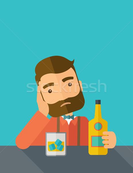 Sad man alone in the bar drinking beer. Stock photo © RAStudio