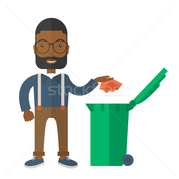 Black man throwing paper in a garbage bin. Stock photo © RAStudio