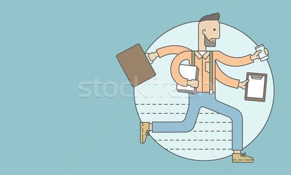 Worker with multitasking job. Stock photo © RAStudio