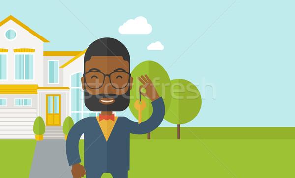 Agente immobiliare barba occhiali chiave casa Foto d'archivio © RAStudio