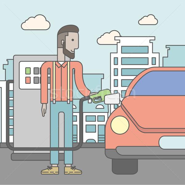 Man filling up fuel into car. Stock photo © RAStudio