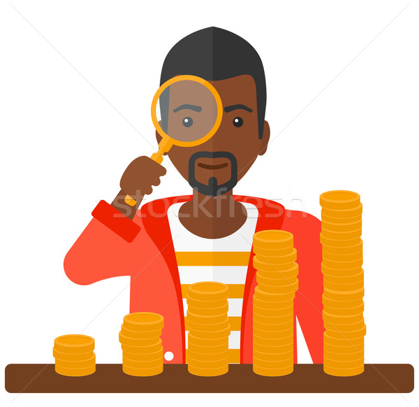Man with magnifier and golden coins.  Stock photo © RAStudio