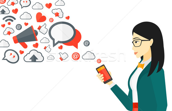 применения азиатских женщину смартфон применение Сток-фото © RAStudio