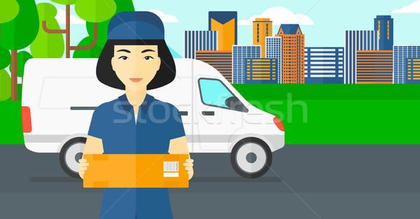 Woman delivering box. Stock photo © RAStudio