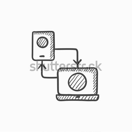 Synchronization smartphone with laptop sketch icon. Stock photo © RAStudio