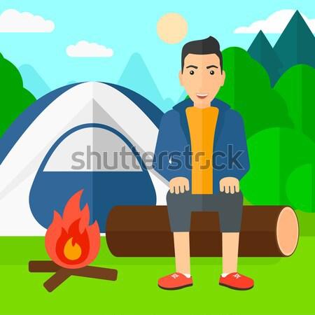 Man sitting at camp. Stock photo © RAStudio