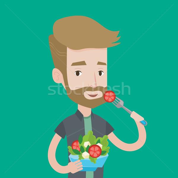 Uomo mangiare sano vegetali insalata barba Foto d'archivio © RAStudio