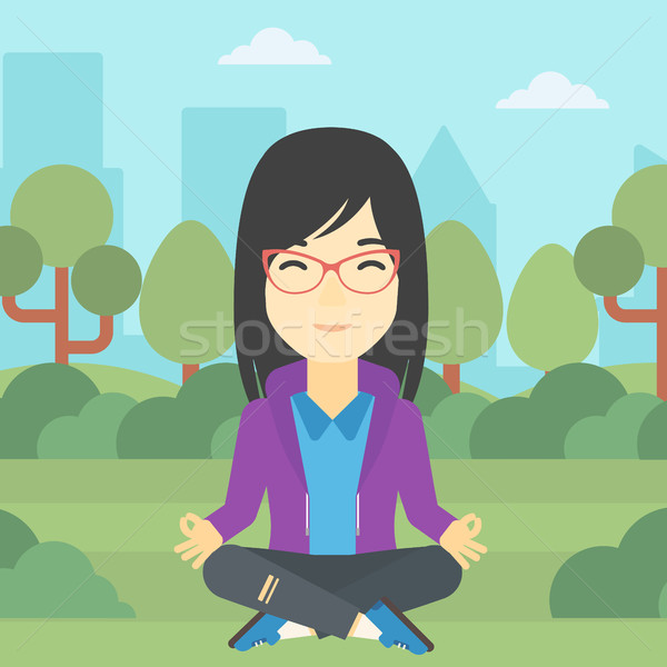 Business woman meditating in lotus position. Stock photo © RAStudio
