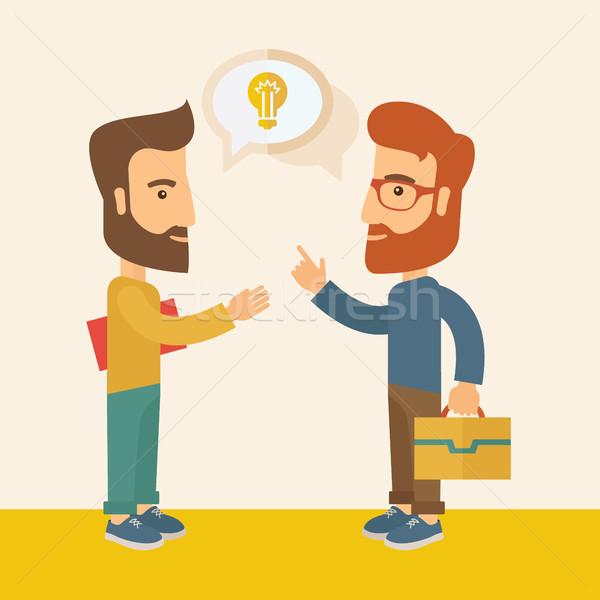 Stock photo: Two men sharing ideas.