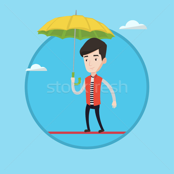 Risky businessman balancing on a tightrope. Stock photo © RAStudio