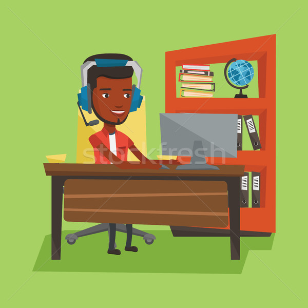 Business man with headset working at office. Stock photo © RAStudio