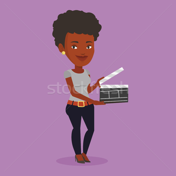 Smiling woman holding an open clapperboard. Stock photo © RAStudio