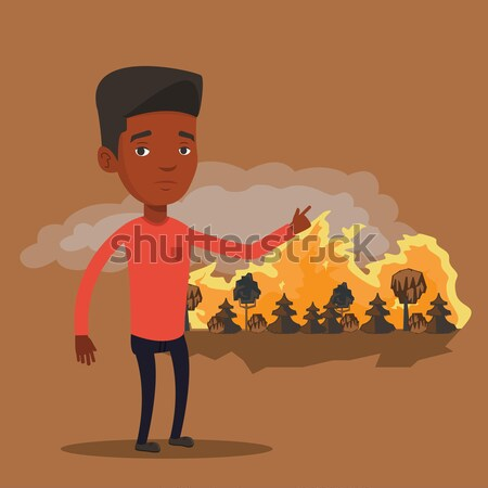 Man standing on background of forest fire. Stock photo © RAStudio