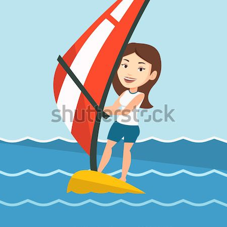 Young man windsurfing in the sea. Stock photo © RAStudio