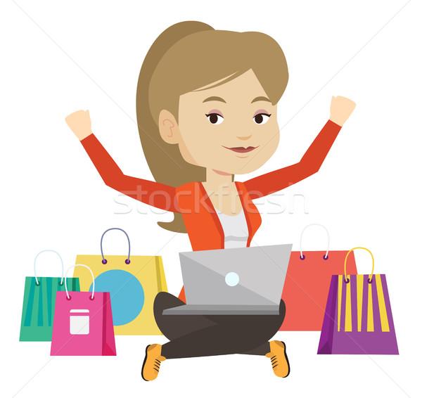 ストックフォト: 女性 · ショッピング · を · 白人 · ラップトップを使用して