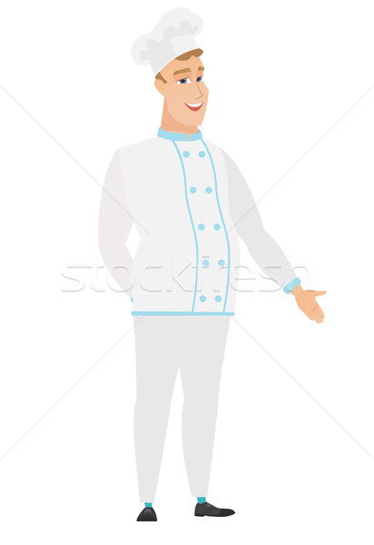Caucasian chef cook with hand in his pocket. Stock photo © RAStudio